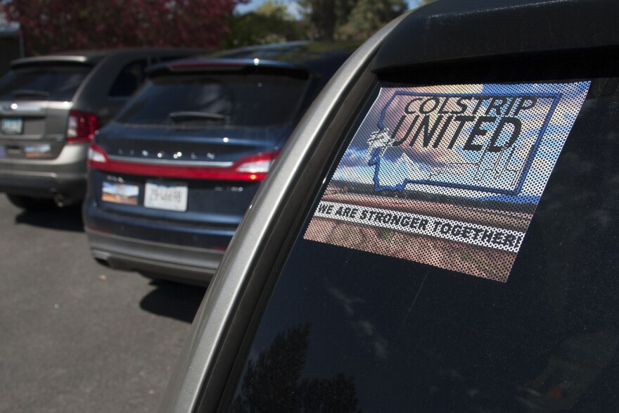 """""""Colstrip United"""" banners, posters and car stickers can be seen all around Colstrip, Mont. The group aims to elevate pro-coal voices in the larger debate about energy."""