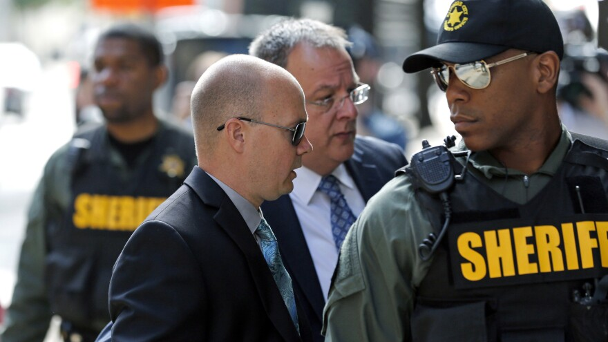 Lt. Brian Rice (second from left) was acquitted Monday in the 2015 death of Freddie Gray. Rice is seen here arriving at the courthouse for opening statements in his trial in Baltimore on July 7.
