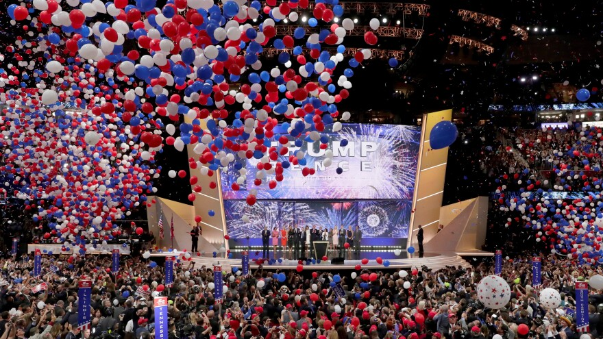 Republican Presidential Candidate Donald Trump, and Republican Vice Presidential Nominee Gov. Mike Pence of Indiana watch with their families as the balloons fall during the final day of the 2016 Republican National Convention in Cleveland.