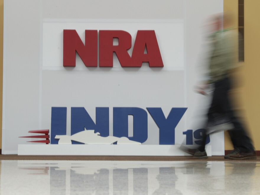 A visitor to the at the National Rifle Association annual meeting walked past signage for the event in Indianapolis, Saturday, April 27, 2019.