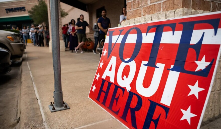 Voters line up outside a polling location in March