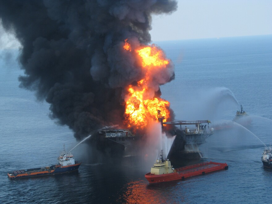 Anchor-handling tugboats battle the blazing remnants of the off shore oil rig Deepwater Horizon in 2010.