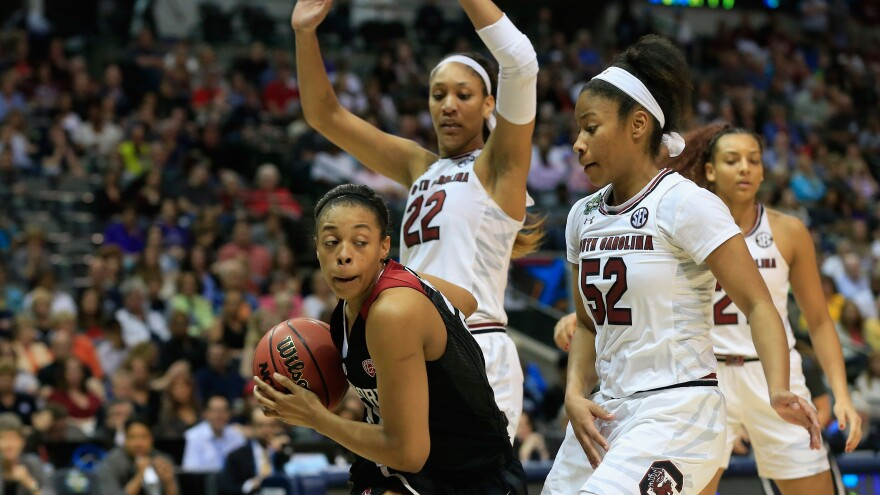 Erica McCall of the Stanford Cardinal drives against Tyasha Harris and A'ja Wilson of the South Carolina Gamecocks in the second half Friday during the semifinal round of the 2017 NCAA Women's Final Four in Dallas.