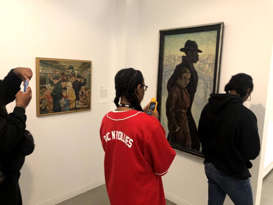 Students looking at painting at Wolfsonian Gallery.jpg
