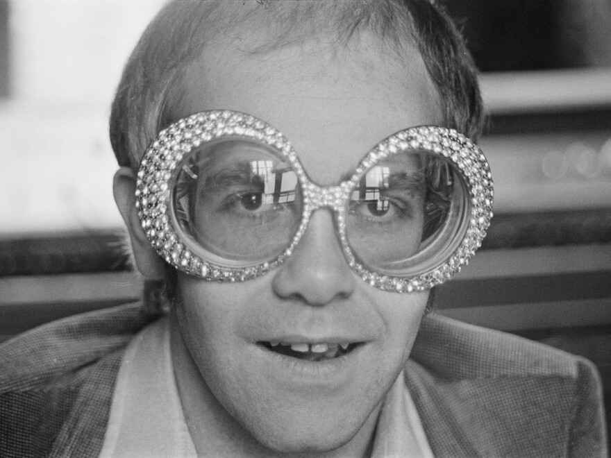 In his memoir, <em>Me</em>, British singer-songwriter Elton John, shown in 1974, shares revelations about his sexual orientation and his struggle with cocaine.