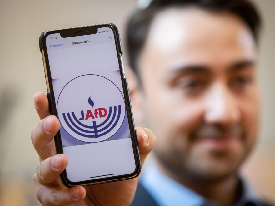 Leon Hakobian shows on his mobile phone a preliminary draft of a logo for a new Jewish grouping within Germany's far-right Alternative for Germany party, during the Jewish group's founding event on Oct. 7 in Wiesbaden, a city in Germany's western state of Hesse.
