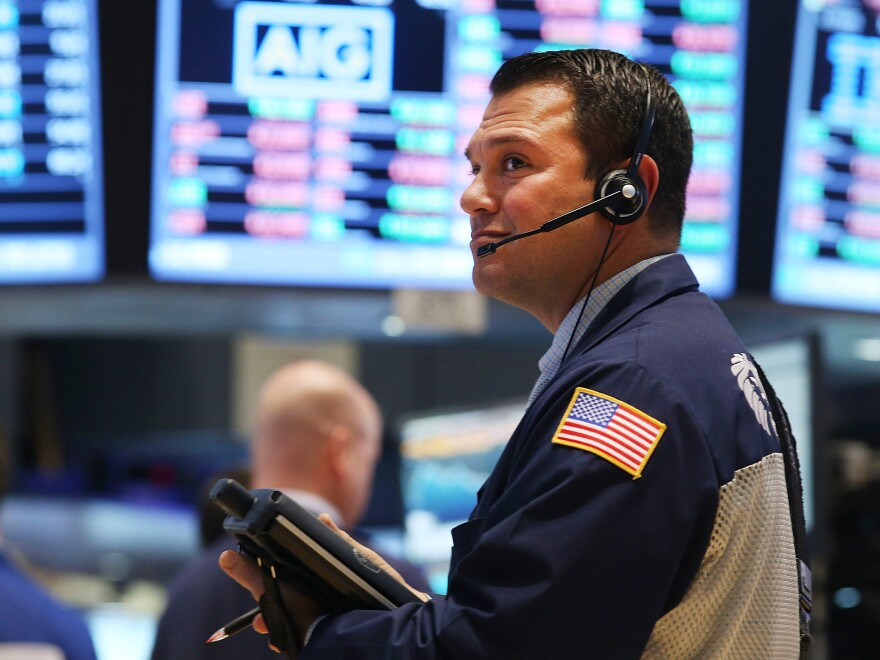 A trader works on the floor of the New York Stock Exchange on Wednesday. Stocks took a beating, with key indexes falling more than 2 percent before bouncing back slightly.