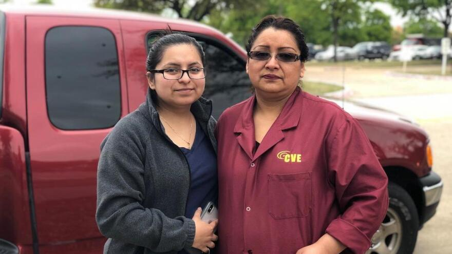Socorro Lechuga (right), who has worked for CVE Technology Group for about six years, was released by ICE agents conducting a raid at the company. Maria Soria (left) came from a nearby town to be with her mother.