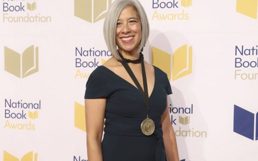 Susan Choi poses with a medal around her neck at the National Book Awards.