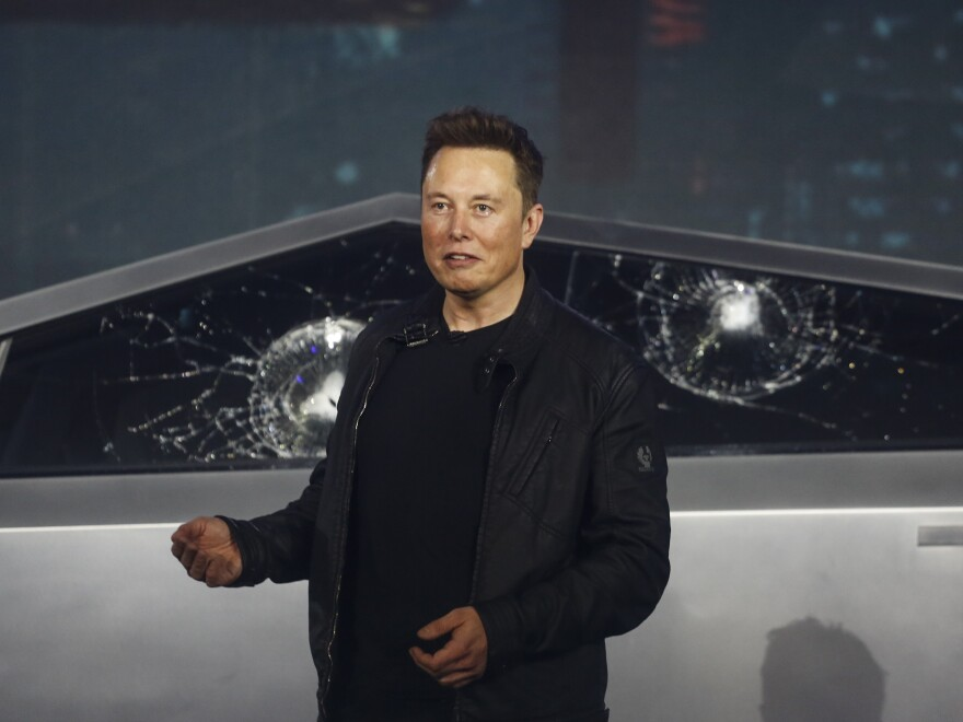 Tesla co-founder and CEO Elon Musk introduces the Cybertruck at Tesla's design studio in Hawthorne, Calif. The much-hyped unveiling of the company's electric pickup truck went off script Thursday night when supposedly unbreakable window glass was smashed twice by a large metal ball.