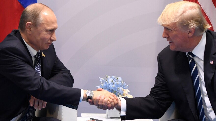 President Trump and Russian President Vladimir Putin shake hands during a meeting on the sidelines of the Group of 20 summit in Hamburg, Germany, on Friday.