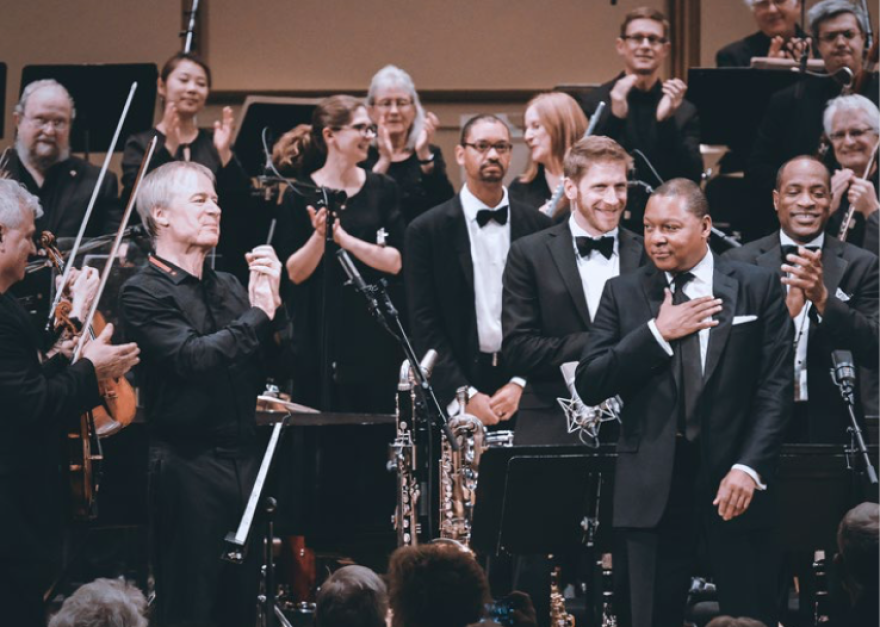 """Wynton Marsalis, seen near the right of the frame, wrote """"Swing Symphony"""" and recorded it in a collaboration between St. Louis Symphony Orchestra and Jazz At Lincoln Center Orchestra. [12/3/19]"""