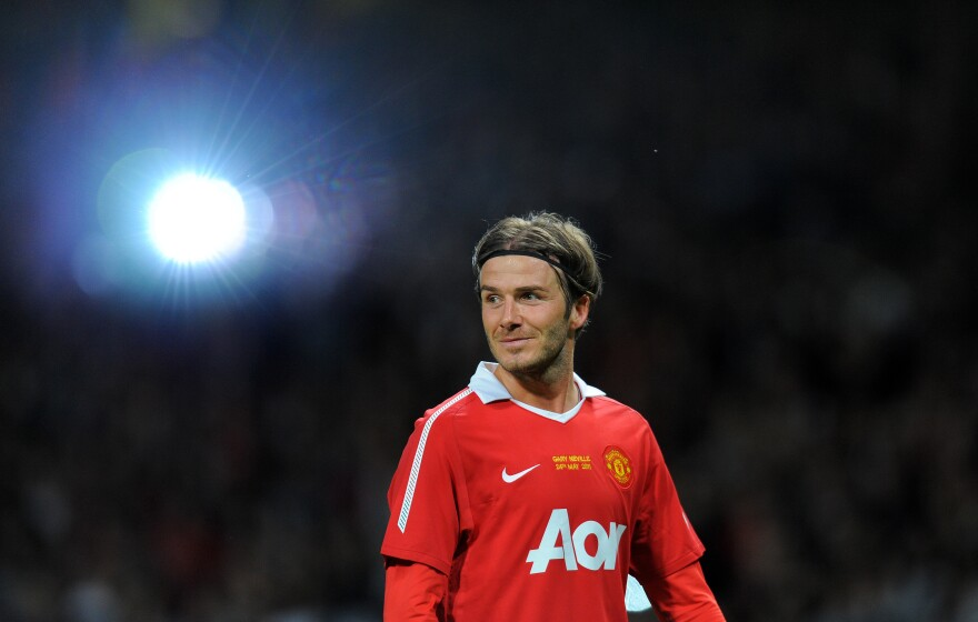 This file photo taken in 2011 shows former Manchester United player David Beckham after a testimonial football match between Manchester United and Juventus for Manchester United's Gary Neville.