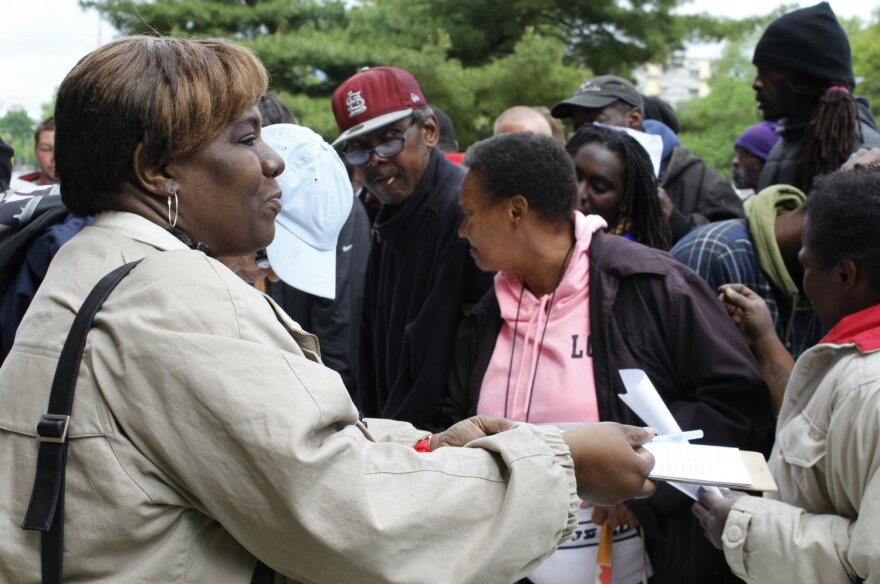 Caryon Kirklind-Nelson is handing the petition to homeless people in front of City Hall. She heard about the event in her church and wanted to help. 04/27/2017 City Hall entrance and Market Street