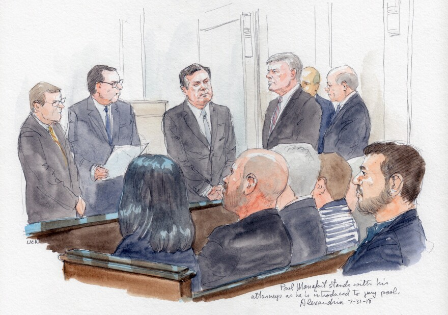 Paul Manafort (center), standing with his lawyers, is introduced to jury pool on Tuesday.