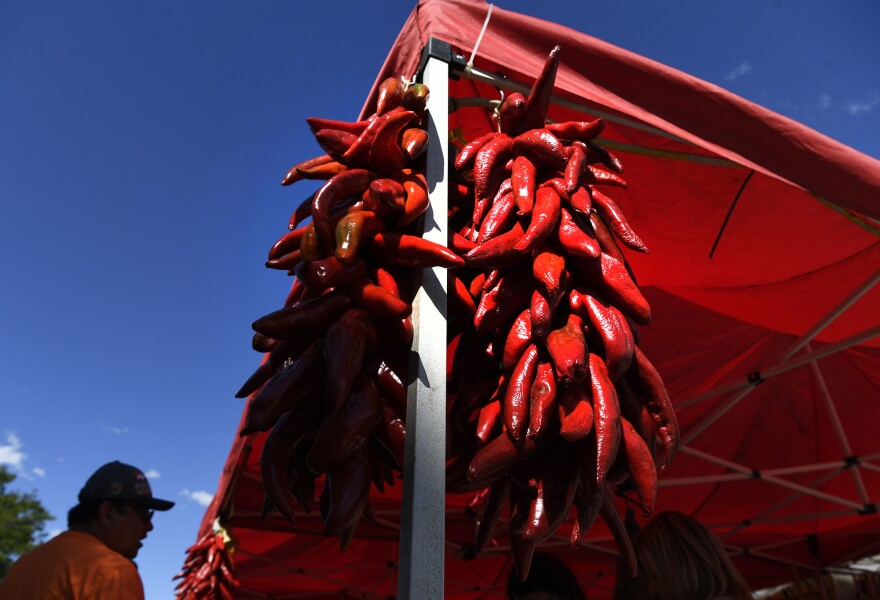 Pueblo Chiles are on display and for sale at the Di Tomaso Farms tent at the 2016 Chile and Frijoles Festival.