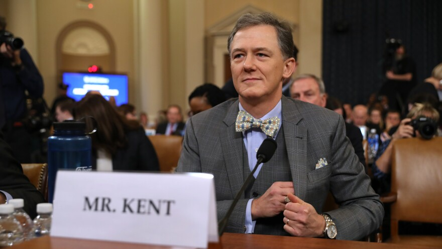 Deputy Assistant Secretary for European and Eurasian Affairs George Kent waits to testify before the House Intelligence Committee on Capitol Hill on Wednesday.