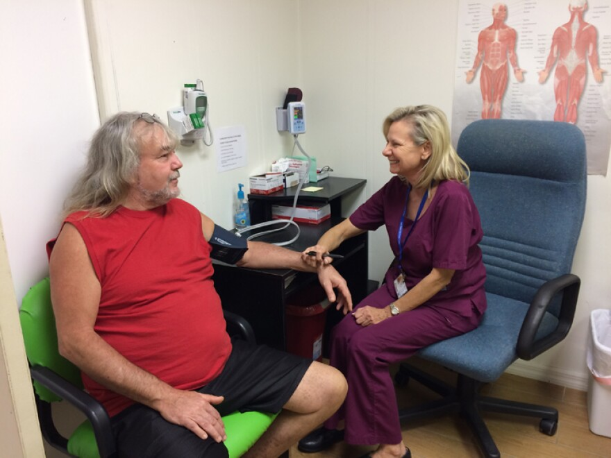 Kim Harden takes a patient's blood pressure at the Lake Wales Free Clinic.