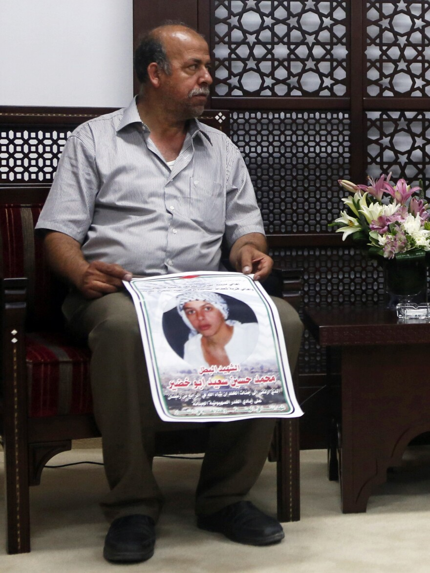 On Monday, Hussein Abu Khdeir, father of 16-year-old Palestinian Mohammed Abu Khdeir, held a photo of his son as he met with Palestinian President Mahmoud Abbas in the West Bank. On Tuesday, the Abu Khdeir family received Israeli guests who wanted to apologize for their loss.