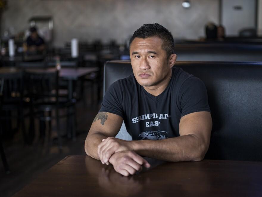 Mike Trinh — kick boxer turned restauranteur — sits inside Mike's Seafood in Houston's Little Saigon