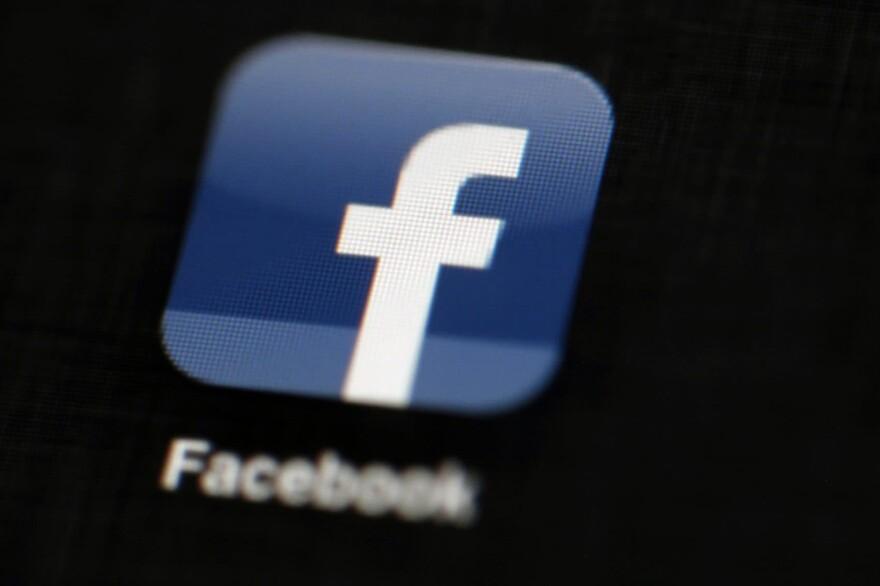 The Facebook logo in 2012 is displayed on an iPad in Philadelphia. (Matt Rourke, AP file photo)