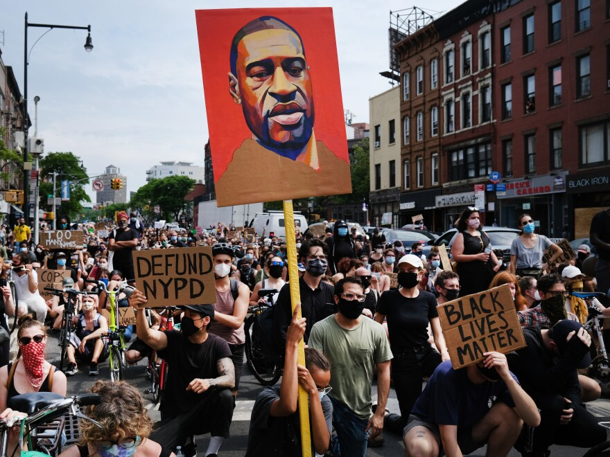 Protesters march in downtown Brooklyn over the killing of George Floyd by a Minneapolis Police officer on June 5, 2020 in New York City.