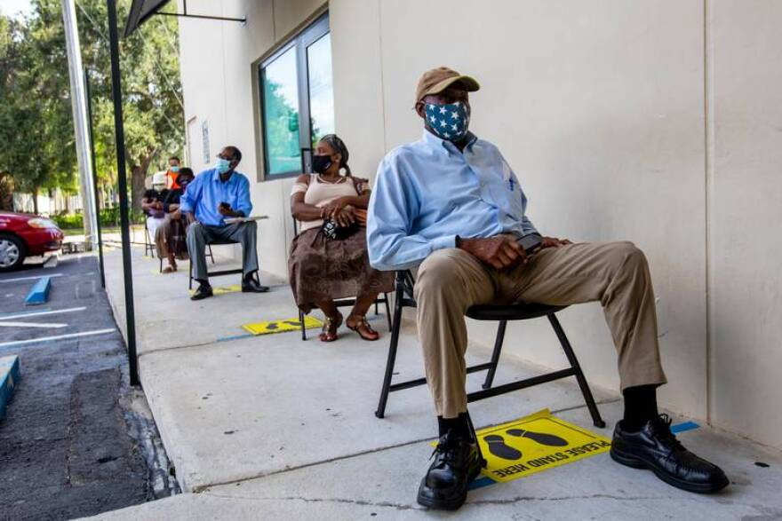Perejona Lavenal waits for assistance with unemployment at Sant La Haitian Neighborhood Center in North Miami on Aug. 11, 2020. Deloitte Consulting's work on the state's unemployment system left millions of Floridians unable to collect unemployment claims.