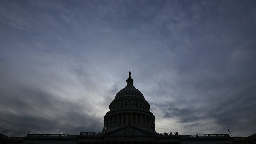 The U.S. Capitol is shown at sunset on Oct. 15, the 15th day of a government shutdown that some analysts say damaged the U.S. reputation worldwide.