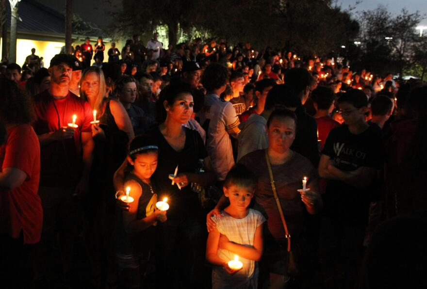 Students, parents and community members gather for a sunset vigil at Pine Trails Park in honor of the victims of the Marjory Stoneman Douglas High School shooting.