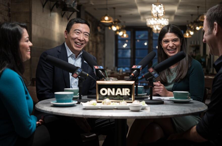 Presidential hopeful Andrew Yang, NPR host and correspondent Noel King (center, right), and undecided voters Hetal Jani and John Zeitler talk politics over fried soup dumplings at Baodega in Manhattan.