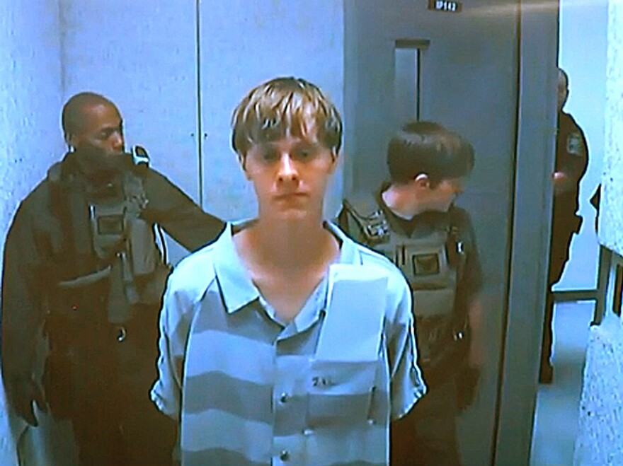 Dylann Roof appears via video before a judge in North Charleston, S.C, today. The 21-year-old man accused of killing nine people inside a black church in Charleston made his first court appearance and bail was set for $1 million on a charge of weapons possession. The judge said he did not have the authority to set bail on the nine counts of murder against Roof.