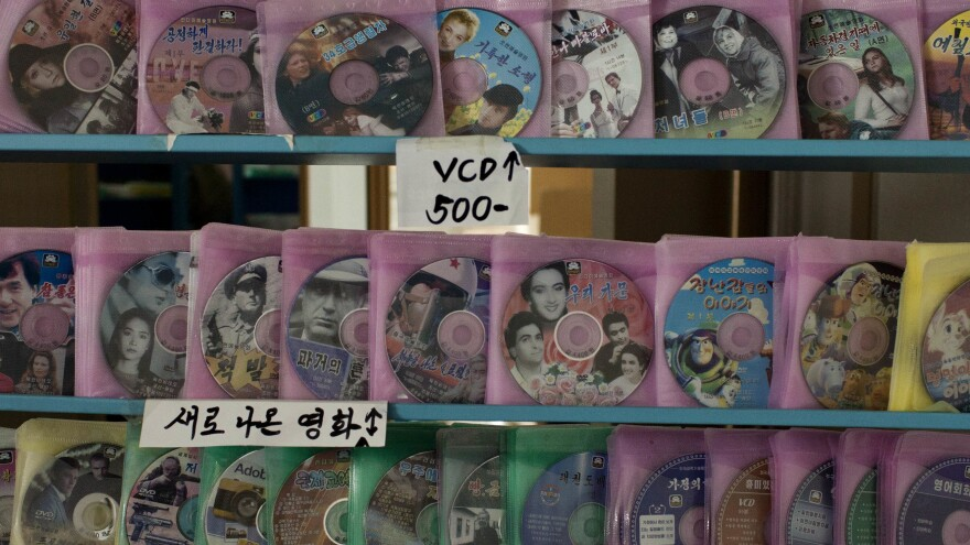 "A recent study found that TVs and DVD players have ""reached near ubiquity in North Korea across nearly all demographic, socio-economic and political class divides."" Some shops in Pyongyang offer DVDs and video CDs for sale, as shown here. Foreign movies or videos are often stored instead on USB sticks or micro SD cards and sold on the black market."