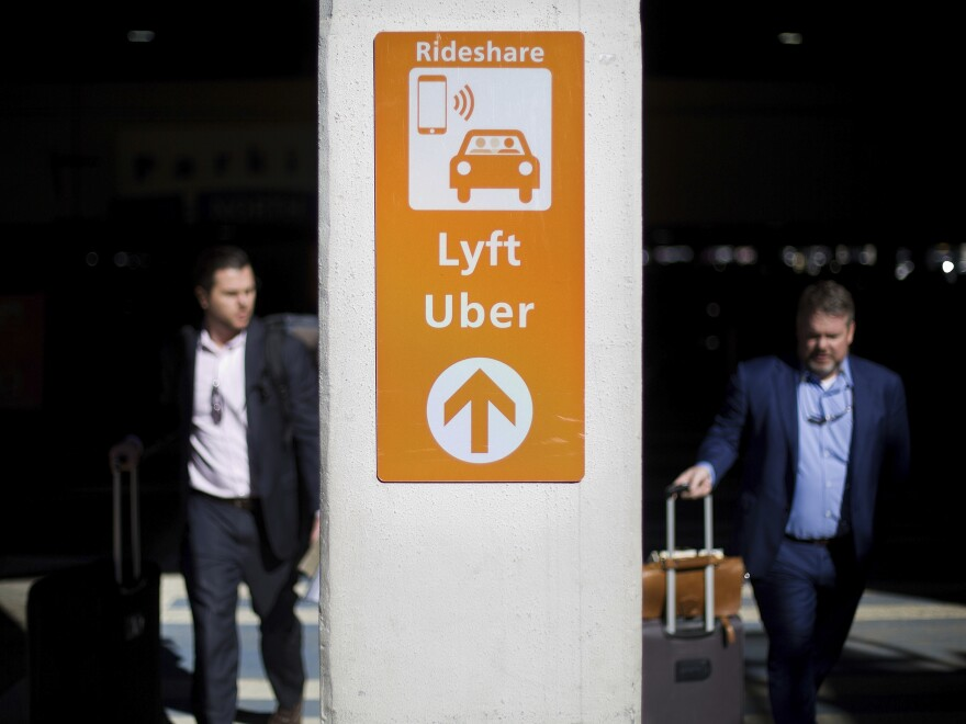 Uber and Lyft drivers say they are seeing less demand for rides in big cities where events are being canceled and people are encouraged to work from home.