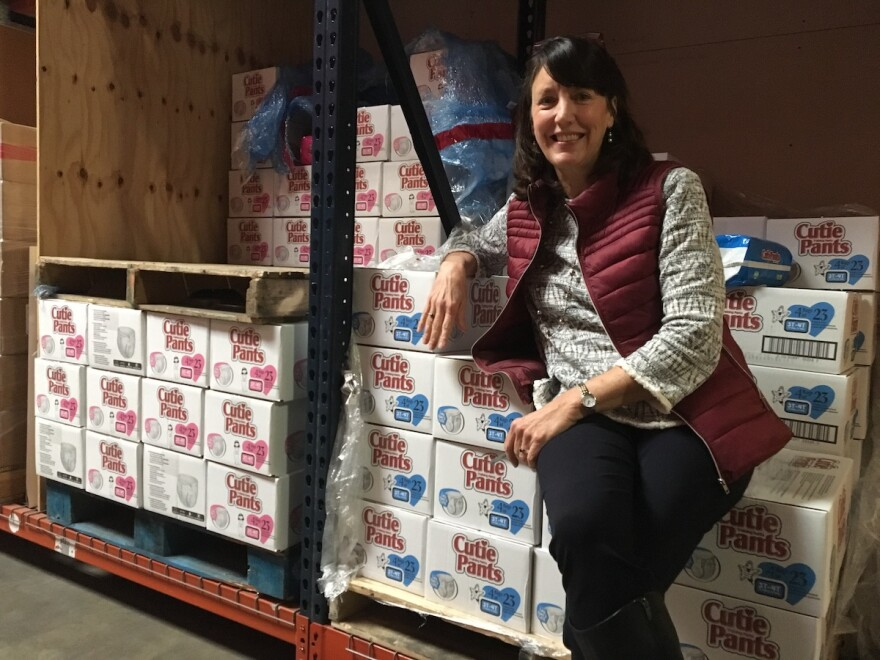 Barbara Johnson, CEO of Hope Supply Co., surrounded by Cutie Pants diapers. Hope Supply Co. funnels baby essentials to nonprofits throughout North Texas.