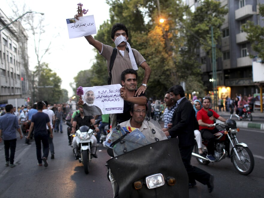 Hasan Rowhani's victory in Iran's presidential election produced street celebrations in Tehran on Saturday, in sharp contrast to the weeks of violent protests that followed a disputed election four years ago. Rowhani is being hailed as a moderate, though hard-line clerics are still seen as the most powerful force in the country.