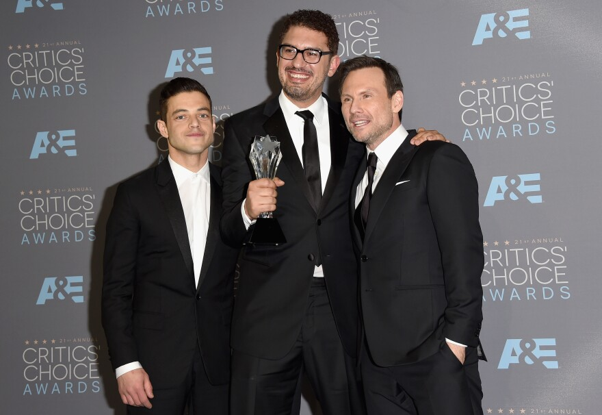 """<em>Mr. Robot</em> actor Rami Malek (from left), writer/producer Sam Esmail and actor Christian Slater, at the Critics' Choice Awards in Santa Monica, Calif., in 2016.  """"Their spirit's in exposing these frauds and abuses by people in power,"""" Esmail says of hacktivists. """"And that's just something on a human level I respect."""""""