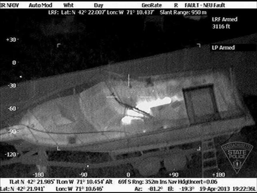 Image taken from Massachusetts State Police Air Wing during the manhunt in Watertown. Police could detect the suspect's body inside a boat in a resident's backyard.