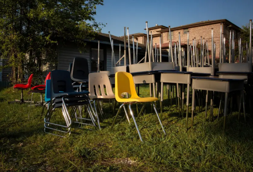 Surplus desks and chairs are provided to help students create effective learning spaces in their homes at the Drive-Thru Student School Supply Giveaway at Raul Yzaguirre Schools for Success in Houston on Saturday.