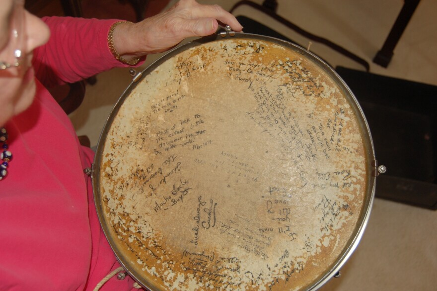 """""""To a swell gal with best wishes"""" — Jo Singletary Barbre holds a snare drum signed by her fellow Darlinettes."""