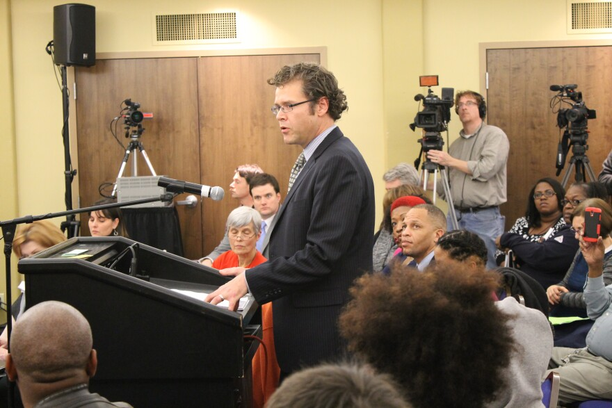 Arch City Defenders executive director Thomas Harvey speaking during a 2014 meeting of the Ferguson Commission.
