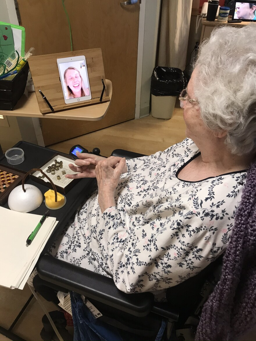 Oaknoll Retirement Residence resident Hope Solomons speaks with University of Iowa student Molly Anderson. Anderson used to work with Solomons in person, but since the COVID-19 outbreak, they have communicated through FaceTime.