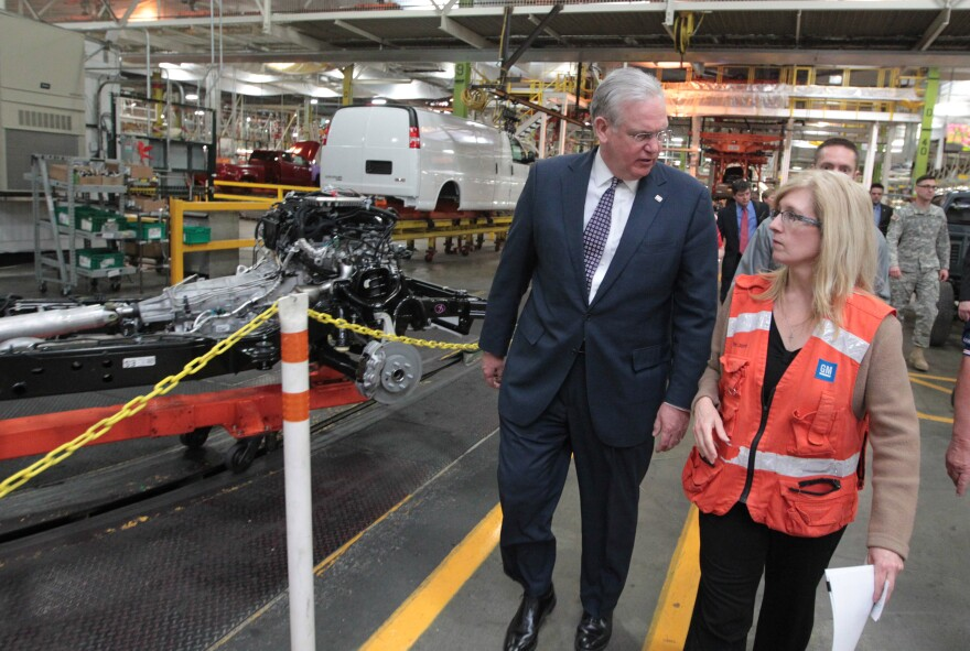 Missouri Governor Jay Nixon talks with Nancy Laubenthal, General Motors Wentzville Plant Manager during a tour of their truck line in Wentzville, Missouri on March 9, 2015. Nixon was on hand to present General Motors with a Flag of Freedom award, recogniz
