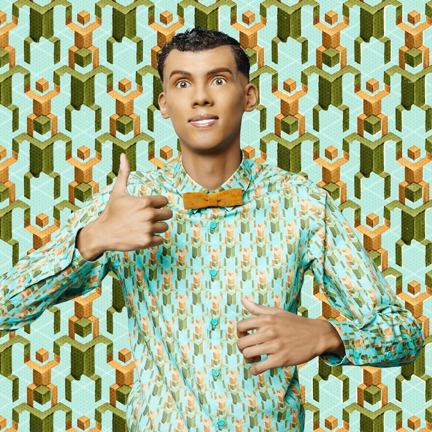 """Belgian music sensation Stromae acts as a mannequin in the music video for """"Papaoutai."""""""