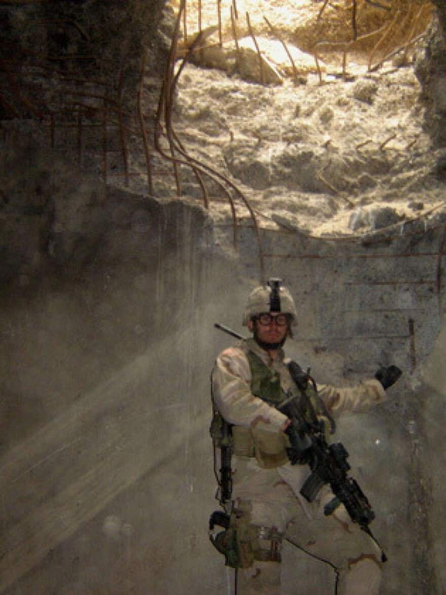 Tom Tarantino stands in a bunker in Iraq. He served in the military for 10 years, and now works as an advocate for veterans at Iraq and Afghanistan Veterans of America.