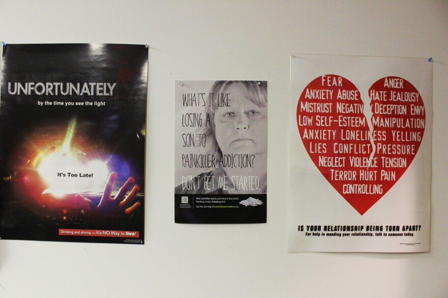 Posters hang in the common room at Health Recovery Services, one of three rehab centers on Main Street in McArthur, Ohio.