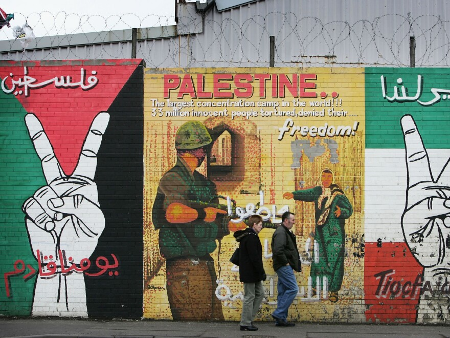 The peace wall on Belfast's Falls Road was traditionally used to display political messages from Irish Republicans. Today, artists use their skills to highlight political messages from around the world.