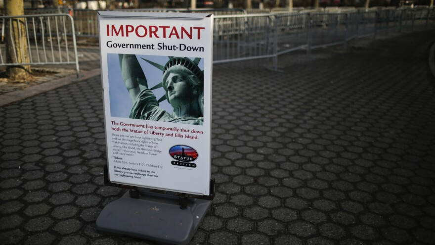 A shutdown placard is seen at the entrance of the Liberty State ferry terminal in Battery Park on January 21, 2018, in New York City.