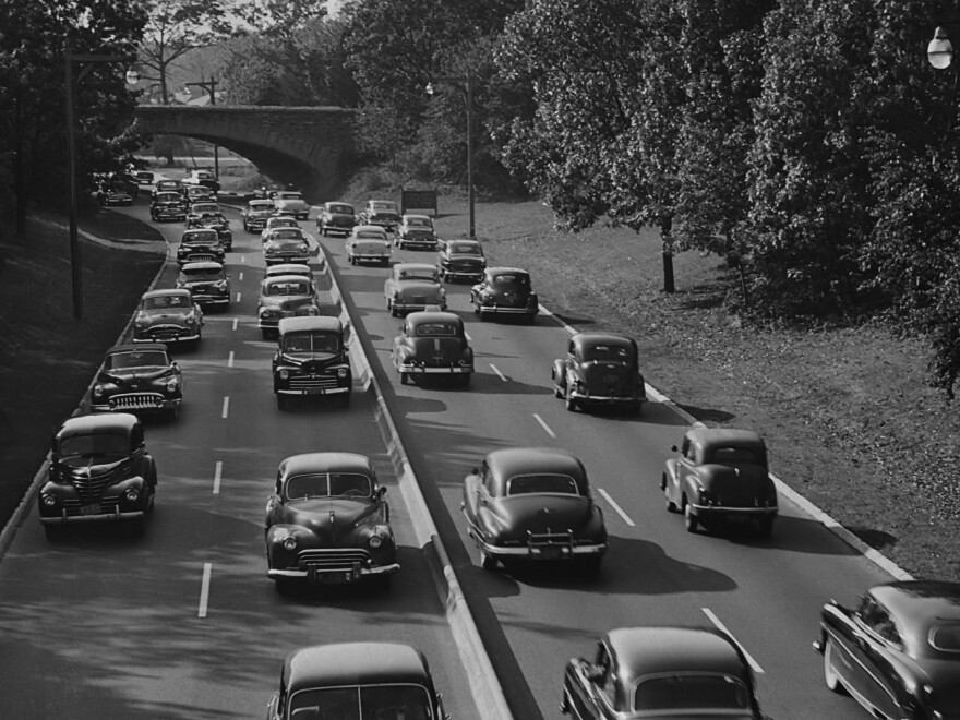 Cars on the Southern State Parkway in Nassau County, circa 1960. The urban planner Robert Moses, according to biographers, designed the road so that bridges were low enough to keep buses — which would likely be carrying poor minorities — from passing underneath on the route from New York City to Long Island's beaches.