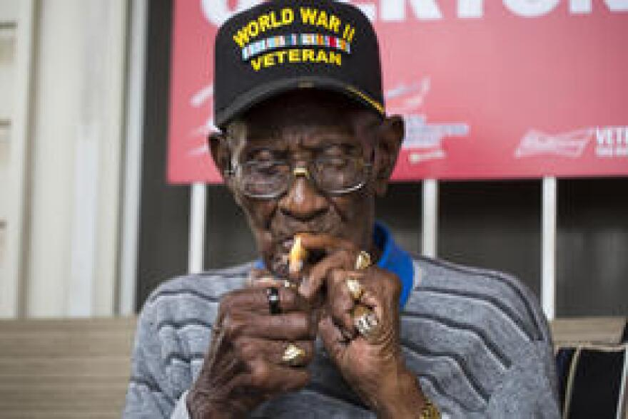 Overton smokes a cigar on his porch during a party to celebrate his 111th birthday.