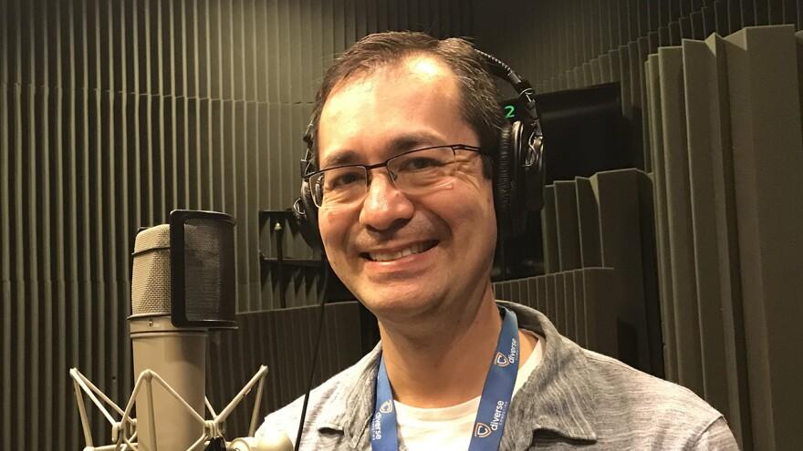 man  wearing headphones and smiling